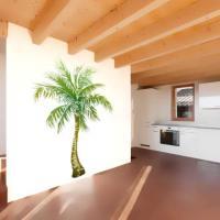 Pochoir mural de palmier peint sur mur interieur style pochoir